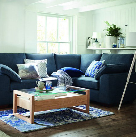 Corner sofa and wooden coffee table