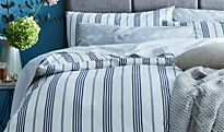 Patterned bed linen on a bed
