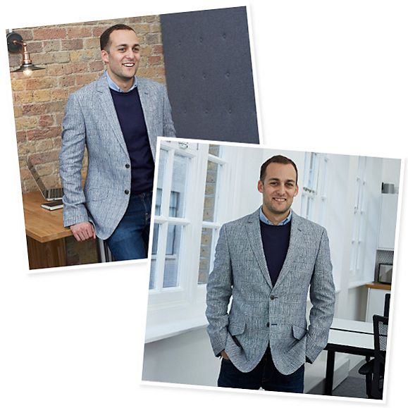 Businessman wearing grey blazer with jeans in the office