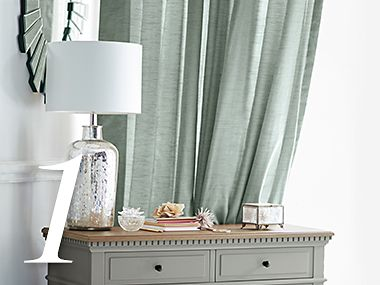 Plain curtains and a console table