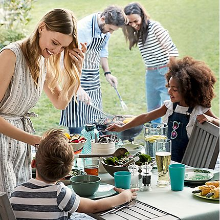 A family preparing a barbecue with BBQ food