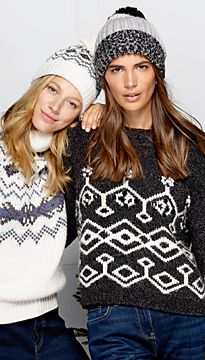 Models wearing patterned Christmas jumpers