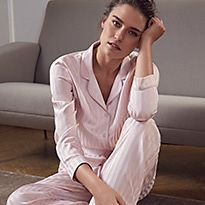 Woman in pink striped pyjamas