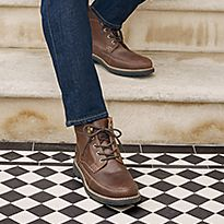 Man wearing brown leather boots
