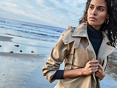 Model wears beige trench coat