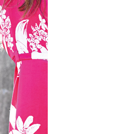 Woman in pink and white floral dress