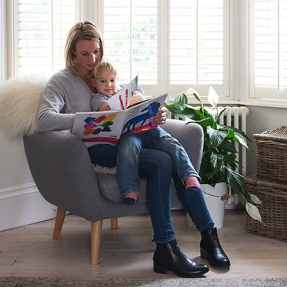 Woman in chair with baby