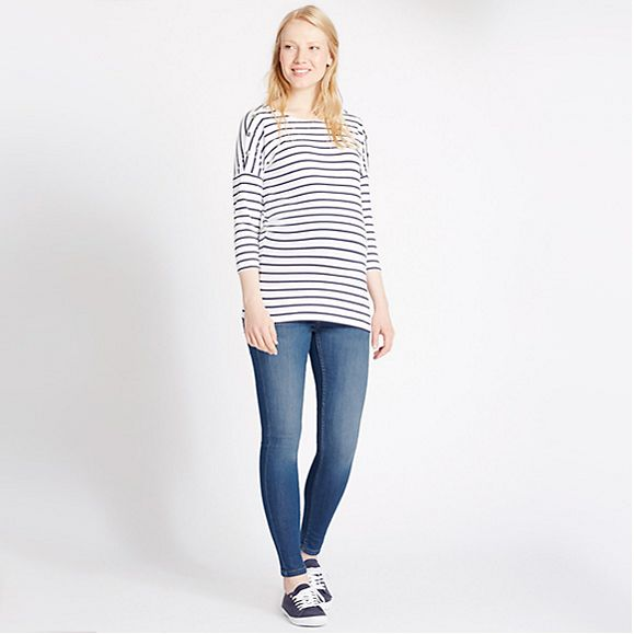Model wearing M&S materbity breton and blue maternity jeans