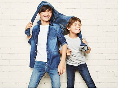 Two boys in denim jeans and jackets