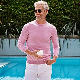 Man wearing pink merino wool jumper