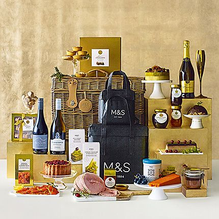 Hamper with food, wine, cakes and cheese