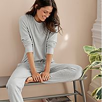 Woman relaxing in grey loungewear