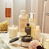 Group shot of beauty products by the bath