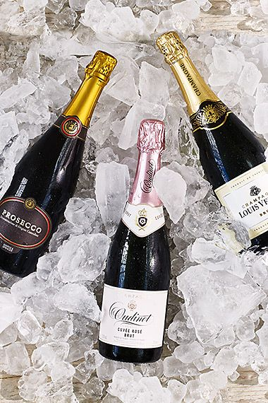 Champagne and prosecco bottles on ice