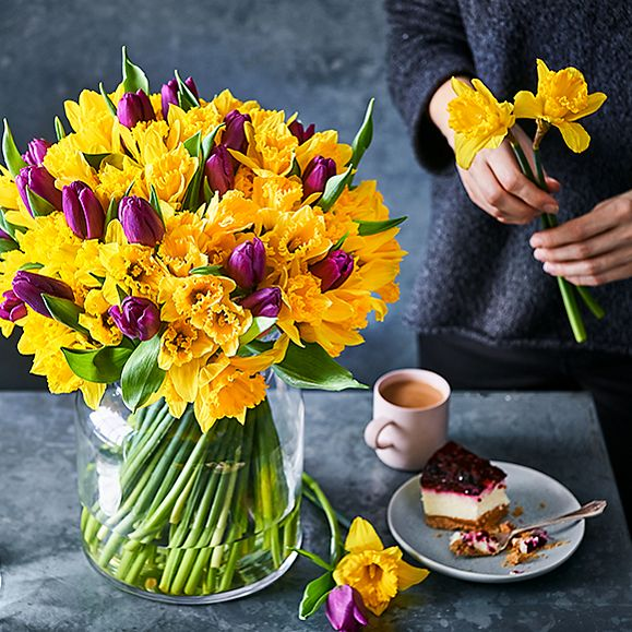 Daffodils and tulips in a vase