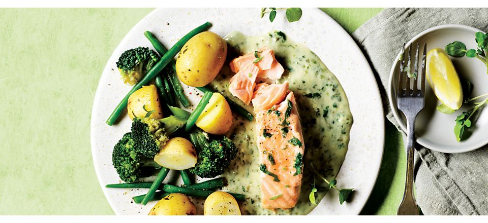 Salmon in a white sauce with new potatoes, green beans and broccoli