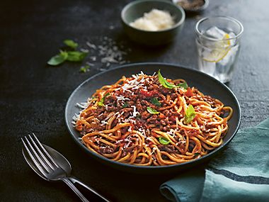 A bowl of spaghetti bolognese with parmesan