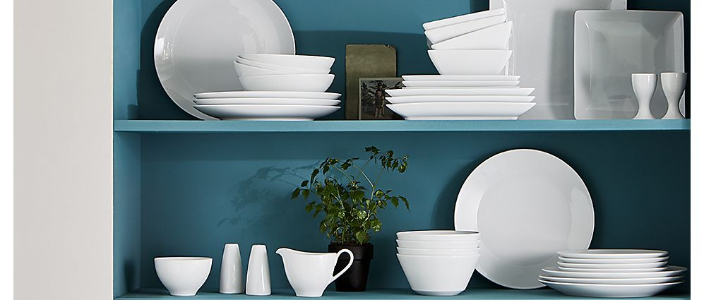 A selection of white and blue dinnerware and crockery