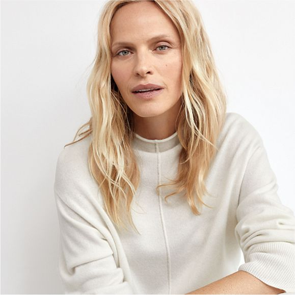 Woman wearing a cream cashmere jumper