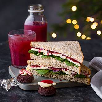 Brie and cranberry sandwich on a plate