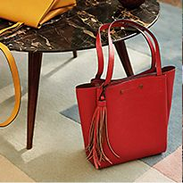 Marble table with yellow and red handbags