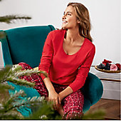 Woman wearing red Christmas pyjamas