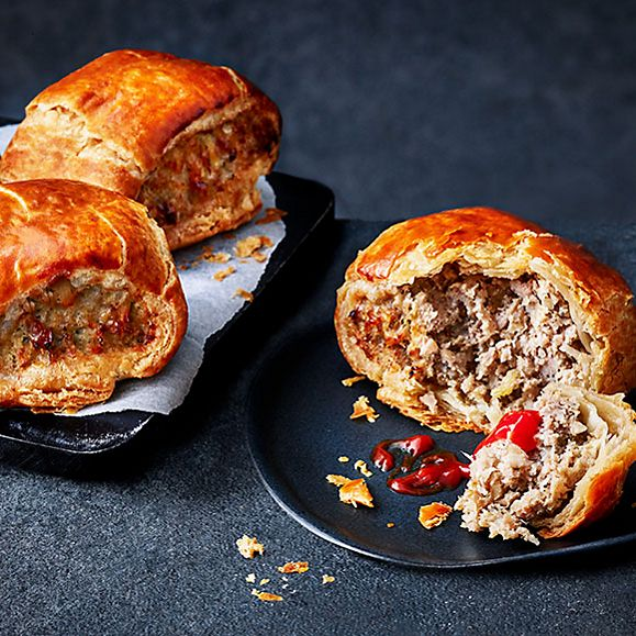 Our Best Ever sausage roll served with ketchup on a plate