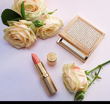 Crystal-studded compact mirror with lipstick and roses