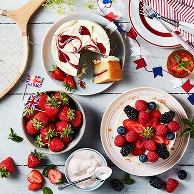 A range of berry desserts including a strawberries and cream cake