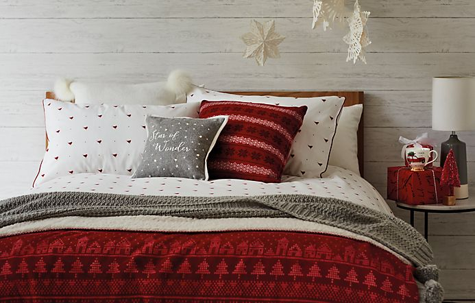 Bed made up with festive bed linen
