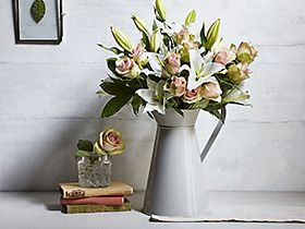Rose and lily bouquet in a jug