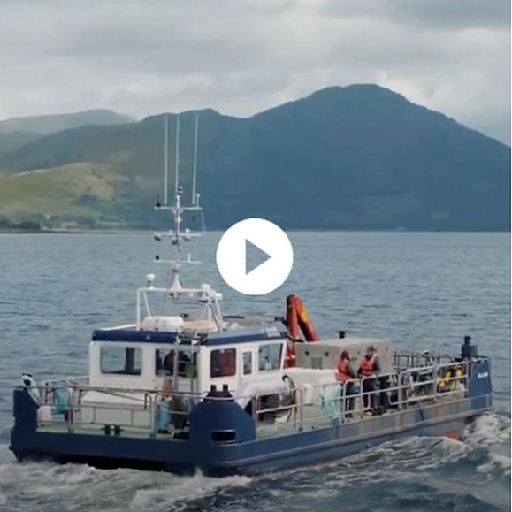 A boat on a Scottish loch fishing for salmon