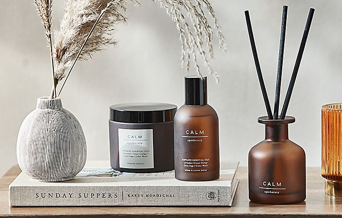 A home fragrance candle, spritz and diffuser