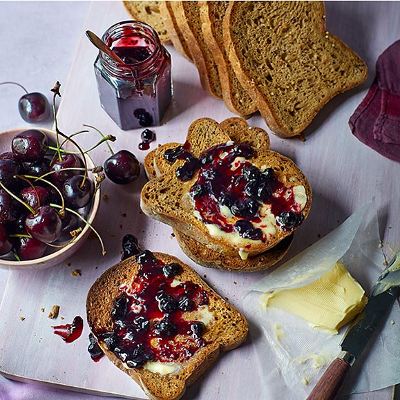 Made Without seeded loaf slices spread with butter and cherry jam