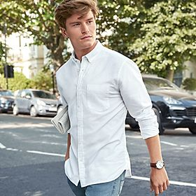Oliver Cheshire wearing a white shirt