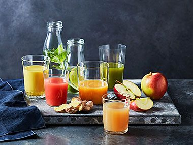 A selection of fruit, juices and smoothies