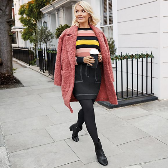 Holly Willoughby wears a pink textured coat, striped jumper, black A-line skirt, tights and ankle boots