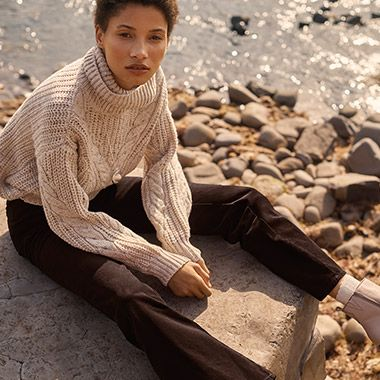 Model wears cable-knit jumper and corduroy trousers from the all-new Per Una collection