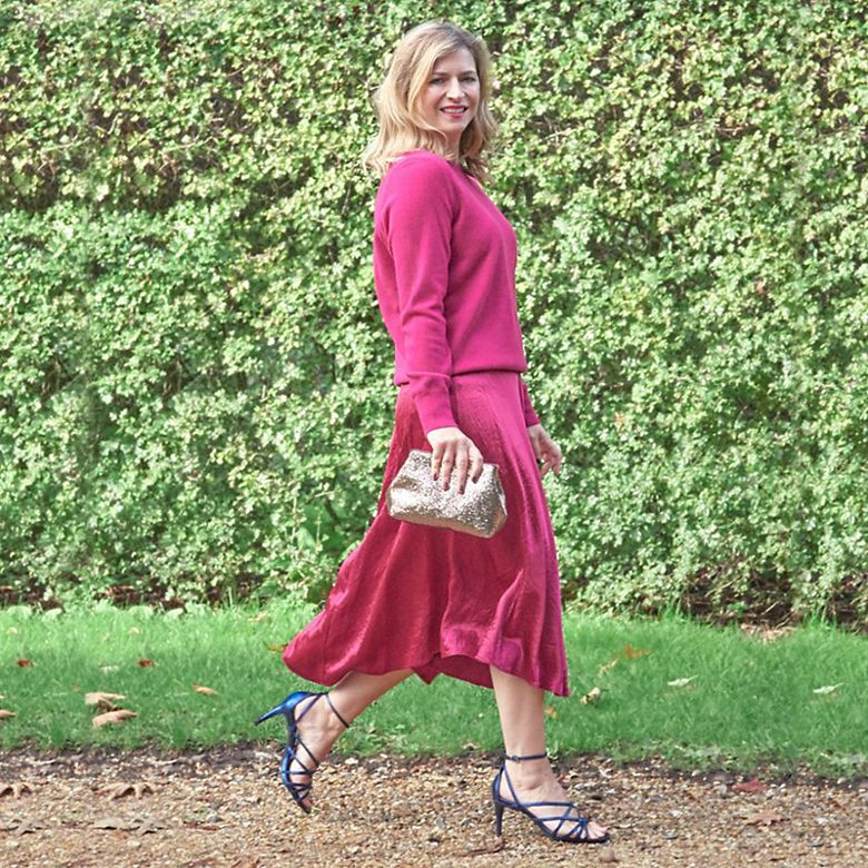 M&S Insider Rachel wearing pink slip skirt, pink cashmere jumper and electric blue heels