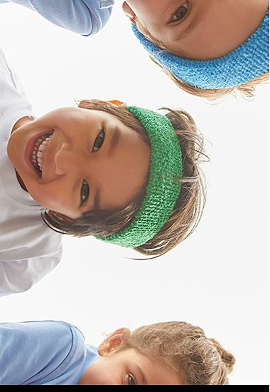 Children in sweat headbands and PE kit