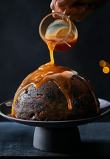 Sticky toffee Christmas pudding with caramel sauce