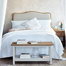 White bedding on a divan bed