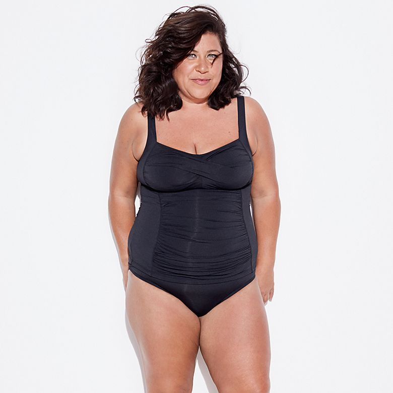 Woman wearing black tankini with roll-top bottoms