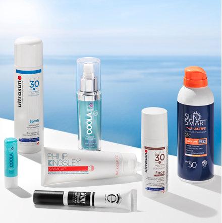 Collection of sunscreens perched beside a pool