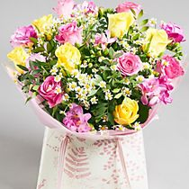 Yellow and pink rose and freesia gift bag