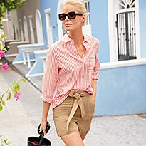 Woman wearing a red and white striped shirt and stone tie-waist shorts