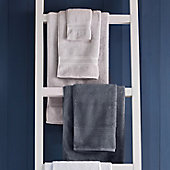 Grey bath towels and hand towels on a towel ladder
