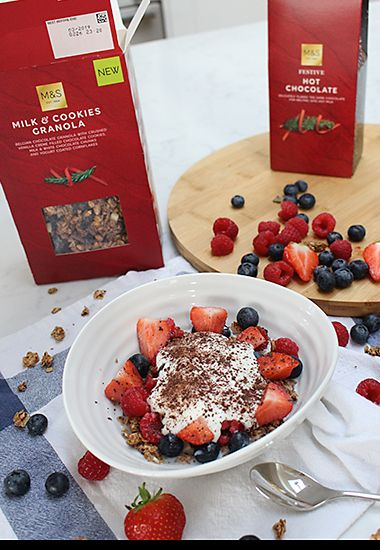 Milk and cookies granola with yoghurt, berries and grated chocolate