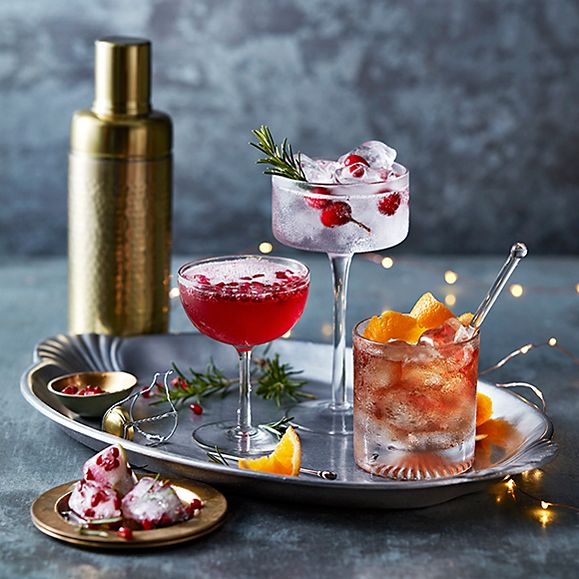 Christmas negroni, Christmas gin and tonic and pomegranate gin fizz on a tray