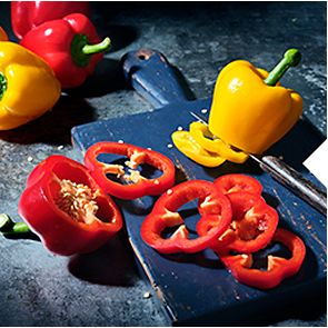 A tray of peppers on a cutting board